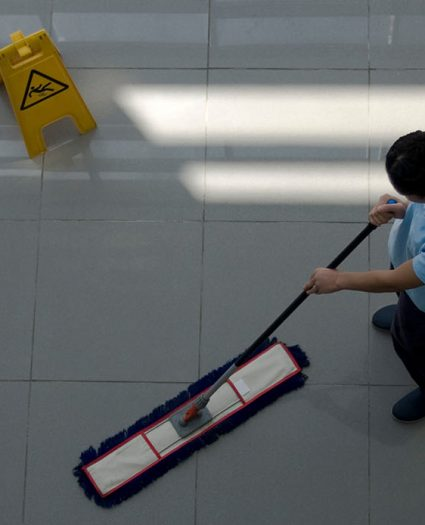 worker is cleaning the floor